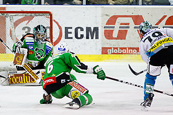 Gregor Baumgartner (EHC Liwest Linz, #79) scores a goal on Matija Pintaric (HDD Tilia Olimpija, #69) during ice-hockey match between HDD Tilia Olimpija and EHC Liwest Black Wings Linz at fourth match in Semifinal  of EBEL league, on March 13, 2012 at Hala Tivoli, Ljubljana, Slovenia. (Photo By Matic Klansek Velej / Sportida)