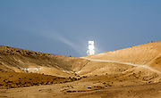 The Ashalim Solar Power station is a solar thermal power station in the Negev desert near the kibbutz Ashalim, in Israel. The station will provide 121 Megawatt of electricity (2.0% of the Israeli consumption), which makes it the largest of its kind in Israel and 5th largest in the world. The mirrors focus sun rays onto the tower, thus producing steam