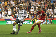 Jayden Mitchell-Lawson (43) of Derby County & Matty Cash (11) of Nottingham Forest during the EFL Cup match between Nottingham Forest and Derby County at the City Ground, Nottingham, England on 27 August 2019.