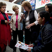 Former Secretary of Health and Human Services, Donna Shala and leader of CARE's Learning Tour trip to Peru, and Congresswoman Kay Granger (R,TX), speak with pregnant women at the San Cosme Health Center. San Cosme is a slum in Lima that has the highest rate of tuberculosis in Lima, but has limited health services for the community. The Global Fund is supporting services in San Cosme's health center.