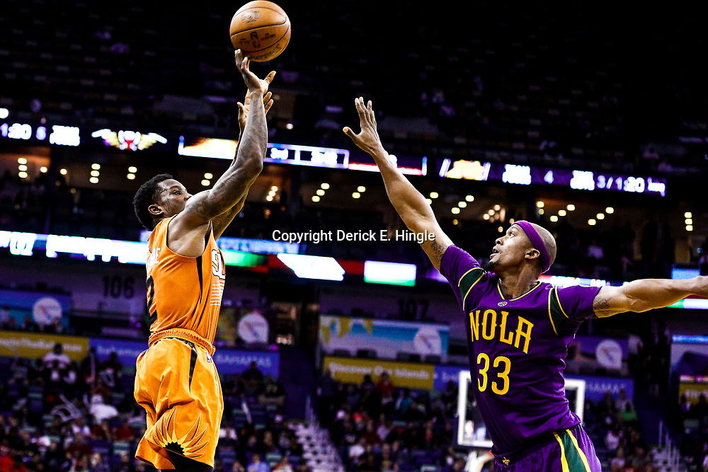Feb 6, 2017; New Orleans, LA, USA; Phoenix Suns guard Eric Bledsoe (2) shoots over New Orleans Pelicans forward Dante Cunningham (33) during the second half of a game at the Smoothie King Center. The Pelicans defeated the Suns 111-106. Mandatory Credit: Derick E. Hingle-USA TODAY Sports