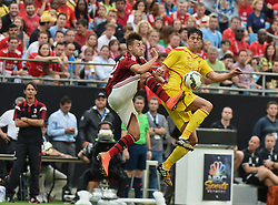 CHARLOTTE, USA - Saturday, August 2, 2014: Liverpool's Martin Kelly in action against AC Milan's Stephan El Shaarawy during the International Champions Cup Group B match at the Bank of America Stadium on day thirteen of the club's USA Tour. (Pic by David Rawcliffe/Propaganda)