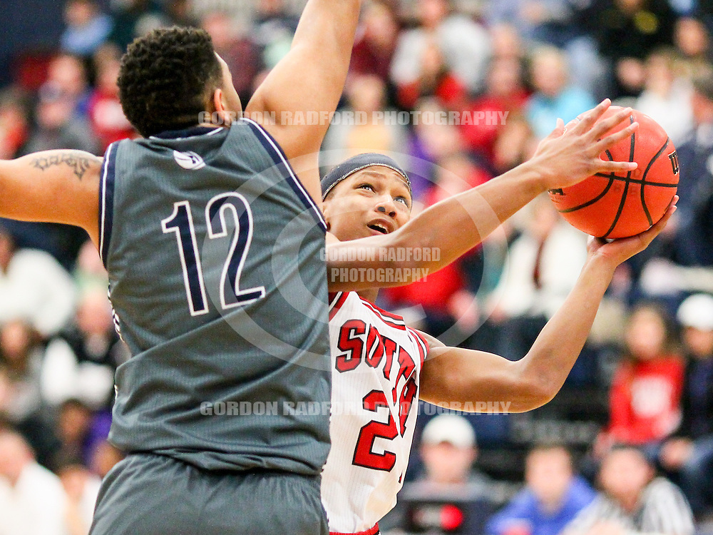 Fort Zumwalt South sophomore Darious Thomas looks for room around Timberland senior Enrique Tankins during a semi-final game in the 22th Annual St. Dominic Christmas Tournament on Tuesday, Dec. 29, 2015 at St. Dominic High School in O'Fallon, Mo.  Gordon Radford | Special to STLhighschoolsports.com