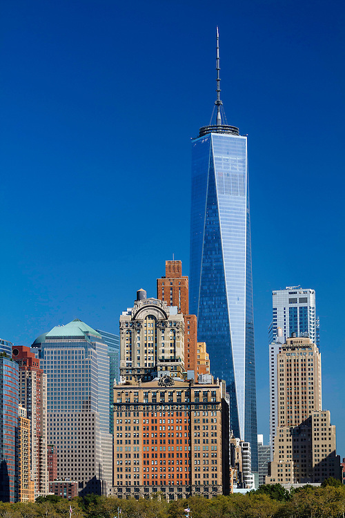 Freedom Tower in downtown Manhattan rises above the other buildings on a warm Fall morning.