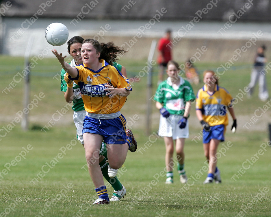 06/08/06<br />Clare's Laurie Ryan gets away from Roisin Upton of Limerick in the All Ireland Ladies U14B Football Final in Portumna, Co. Galway on Saturday.<br />Picture: Don Moloney / Press 22