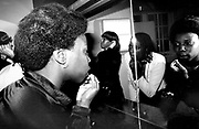 Girls putting on their make up in the bathroom of Shades Disco, Manor House, London 1978