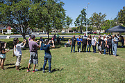 Friends and family take photos as Nob Hill Foods employees pose for a group photo during a Nob Hill Foods farewell BBQ at Strickroth Park in Milpitas, California, on May 15, 2016. (Stan Olszewski/SOSKIphoto)