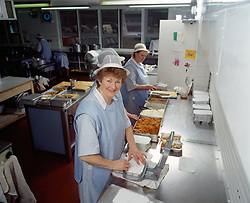 Meals on Wheels food being prepared in kitchen Haringey London UK