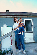 Pine Ridge Sioux Indian Reservation, South Dakota, Oglala Sioux (Lakota) Grassy Creek Tiospaye, young mother and baby