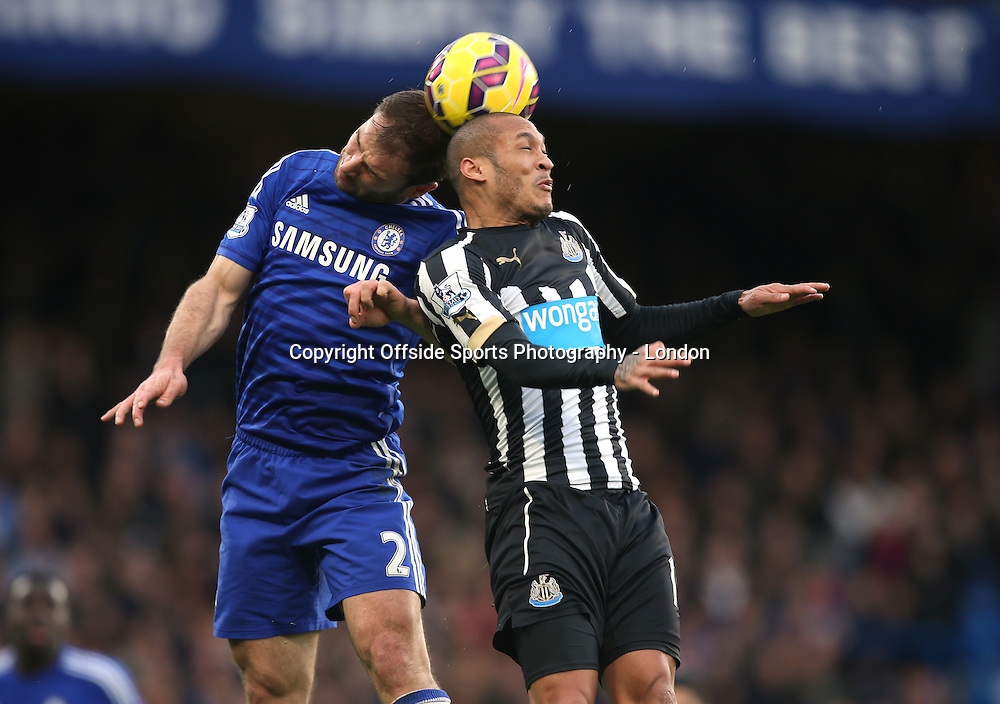 10 January 2015 Premier League Football - Chelsea v Nerwcastle United ; Branislav Ivanovic of Chelsea and Yoan Gouffran of Newcastle go to head the hig ball.<br />  Photo: Mark Leech