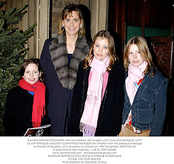 The HON.MRS MONTGOMERY with her children, left to right, LADY CLAUDIA MARQUIS, LADY OLIVIA MARQUIS and LADY CONSTANCE MARQUIS her children from her previous marriage to the Earl of Woolton, at a reception in London on 18th December 2002.	PGG 43