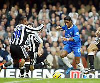 Fotball<br /> England 2004/2005<br /> Foto: SBI/Digitalsport<br /> NORWAY ONLY<br /> <br /> 04.12.2004<br /> <br /> Chelsea v Newcastle United<br /> Barclays Premiership<br /> <br /> Didier Drogba cuts inside Titus Bramble before firing home Chelsea's 2nd goal