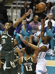 October 17, 2018 - Charlotte, NC, USA - The Charlotte Hornets' Kemba Walker (15) shoots over the Milwaukee Bucks' John Henson (31) in the second half at the Spectrum Center in Charlotte, N.C., on Wednesday, Oct. 17, 2018. The Bucks won, 113-112. (Credit Image: © David T. Foster Iii/Charlotte Observer/TNS via ZUMA Wire)