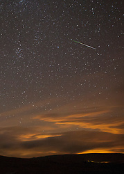 © Licensed to London News Pictures. 12/08/2011. Liverpool, UK. The annual Perseid meteor shower peaks on Saturday 13th August. This shot from last year's shower shows a meteor overhead Ribblehead, North Yorkshire . Photo credit : Andrew Dawson/LNP