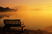 Bench in morning fog alongside Tilton Lake <br /> Sudbury<br /> Ontario<br /> Canada