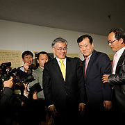 Moon Jae-in arrives to speak and greet supporters at a campaign office in his home district of Sasang in Busan, South Korea, April 11, 2012.