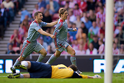 SUNDERLAND, ENGLAND - Saturday, August 16, 2008: Liverpool's Fernando Torres celebrates scoring the match-winning goal against Sunderland with team-mate Fabio Aurelio during the opening Premiership match of the season at the Stadium of Light. (Photo by David Rawcliffe/Propaganda)