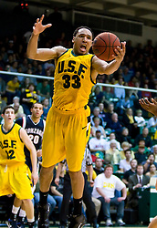 January 30, 2010; San Francisco, CA, USA;  San Francisco Dons forward Dior Lowhorn (33) grabs a rebound in overtime against the Gonzaga Bulldogs at the War Memorial Gym.  San Francisco defeated Gonzaga 81-77 in overtime.