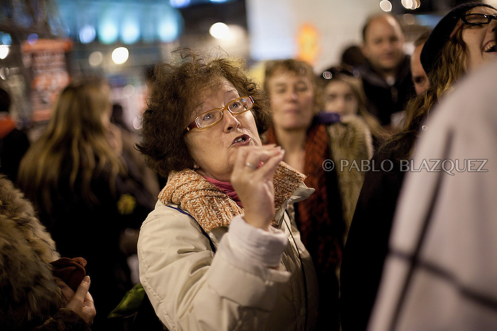 A woman argue with protesters during an 'indignant' demonstration in Puerta del Sol square in Madrid on November 19, 2011 against spending cuts, high unemployment and political corruption, one day before general election. Spain's so-called 'indignant' protest movement was born when thousands of people set up camp in Madrid's Puerta del Sol square ahead of May 22 municipal elections.