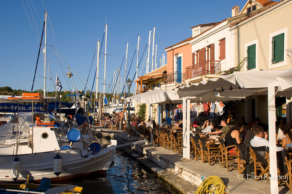 People in waterside cafes in the afternoon in Fiskardo, Kefalonia, the Ionian Islands, Greece