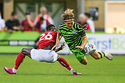 Forest Green Rovers George Williams(11) is tackled by Bristol City's Saikou Jenneh during the Pre-Season Friendly match between Forest Green Rovers and Bristol City at the New Lawn, Forest Green, United Kingdom on 24 July 2019.