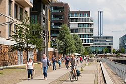 Modern luxury apartment blocks along Dalmannkai promenade  part of modern Hafencity property development in Hamburg Germany