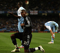 Photo: Paul Thomas.<br /> Manchester City v Chelsea. The Barclays Premiership. 14/03/2007.<br /> <br /> Salomon Kalou celebrates his penalty while City players Micah Richards and Jihai Sun can't believe their luck.