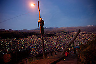 "A puppet hangs as a warning for thieves that they will be lynched and burnt if caught by neighbors, in El Alto, overlooking La Paz city, Bolivia. July, 18, 2010. With crime out of control neighbors in El Alto had decided to protect from thieves by themselves in what they call Justicia Comunitaria (community justice). Puppets are hanged around the city in organized neirghborhoods with signs that read ""caught thieves will be lynched and burnt alive"", and so they do.  Every month mobs attack suspects and burn them alive immediately. In many cases innocent are killed by an uncontrolable mob. Amazingly there havent been any trial against these murder."