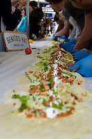 Benito's Hat built Britain's biggest ever burrito, (100ft long) to raise money for Action Against Hunger on World Food Day at King&rsquo;s Cross Square.<br /> <br /> Benito's Hat built Britain's biggest ever burrito, (100ft long) to raise money for Action Against Hunger on World Food Day at King&rsquo;s Cross Square.<br /> Benito's Hat built Britain's biggest ever burrito, (100ft long) to raise money for Action Against Hunger on World Food Day at King&rsquo;s Cross Square.