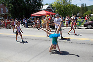 Central Vermont Gymnastic Academy athletes perform cartwheels on Main Street during the Waterbury 4th of July Parade on Saturday