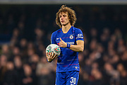 Chelsea defender David Luiz (30) with the ball heading towards the corner flag during the EFL Cup semi final second leg match between Chelsea and Tottenham Hotspur at Stamford Bridge, London, England on 24 January 2019.