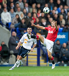 BOLTON, ENGLAND - Sunday, September 26, 2010: Manchester United's Michael Owen and Bolton Wanderers' Paul Robinson during the Premiership match at the Reebok Stadium. (Photo by David Rawcliffe/Propaganda)