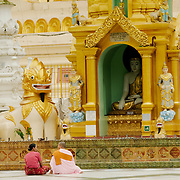 Women praying at Shwedagon Pagoda