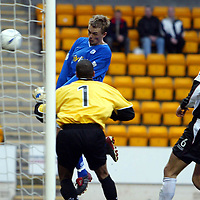 St Johnstone v Ayr United...14.02.04<br />Simon Donnelly heads the ball past Ludovic Roy for St Johnstone's third<br /><br />Picture by Graeme Hart.<br />Copyright Perthshire Picture Agency<br />Tel: 01738 623350  Mobile: 07990 594431