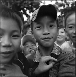 Vietnamese school boys have fun in front of the camera in Vinh, Nhe Anh, Vietnam, Asia