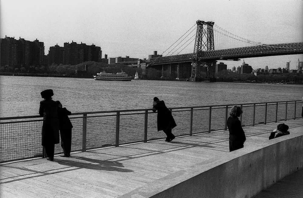 "Orthodox Jews looking back at Manhattan on the East River in the Williamsburg neighborhood of Brooklyn...Part of long-term (2005-2008) story ""I See A Darkness"". New York, NY."