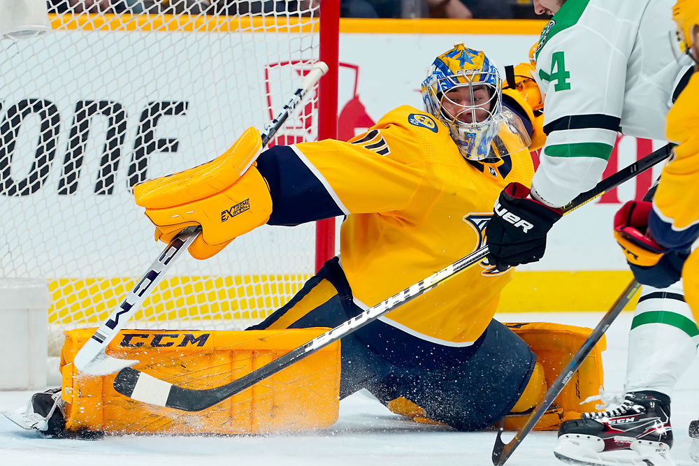 Nashville Predators goaltender Juuse Saros (74) makes a pad save against Nashville Predators goaltender Juuse Saros (74) during an NHL game between the Dallas Stars and Nashville Predators at Bridgestone Arena in Nashville, TN