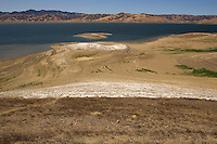 GUSTINE, CA - JULY 16:  The San Luis Reservoir is seen before California Governor Arnold Schwarzenegger speaks at a press conference at the San Luis Reservoir on July 16, 2007 in Gustine California. The governor stressed the importance of a comprehensive water plan as the current system is not prepared to handle the population growth projected for the next 50 years. The reservoir which is filled to just 20.797 percent of capacity and is down 186 feet from normal levels supplies water for the Silicon Valley, Central Valley farms and Southern California homes and businesses.  (Photograph by David Paul Morris)