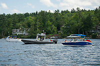 Marine Patrol Supervisor Brian Starck patrols through a no-wake zone between Eagle Island and Governors Island on Lake Winnipesaukee Thursday afternoon.  (Karen Bobotas/for the Laconia Daily Sun)