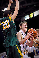 JEROME A. POLLOS/Press..Lake City's Mark Smyly tries to power through the defense of Ben Tucakovic from Borah High during the first half of the T-Wolves 52-46 loss to the Lions at the state 5A boys basketball tournament Thursday at the Idaho Center in Nampa.
