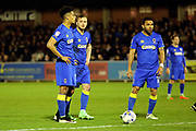 AFC Wimbledon midfielder Dean Parrett (18), AFC Wimbledon striker Lyle Taylor (33), AFC Wimbledon striker Andy Barcham (17) stood around ball, free kick during the EFL Sky Bet League 1 match between AFC Wimbledon and Rochdale at the Cherry Red Records Stadium, Kingston, England on 28 March 2017. Photo by Matthew Redman.