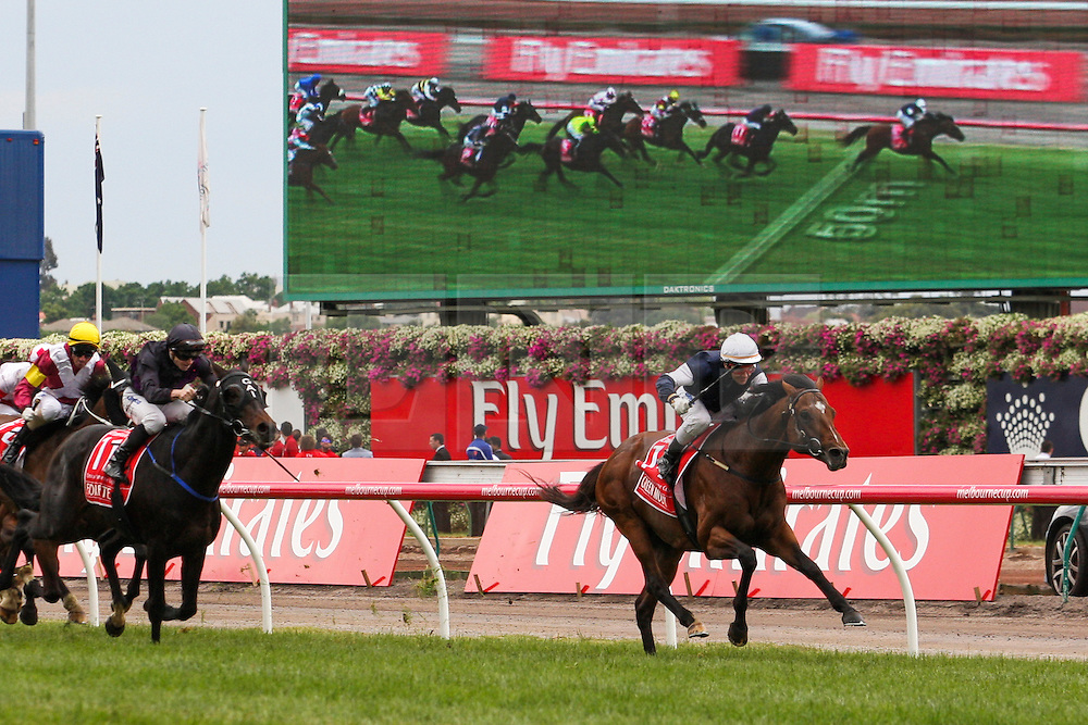© Licensed to London News Pictures. 06/11/2012. Horse, Green Moon ridden by jockey Brett Pebble approaches the finish line during the Emirates Melbourne Cup at the Flemington Racecourse, Melbourne. Photo credit : Asanka Brendon Ratnayake/LNP