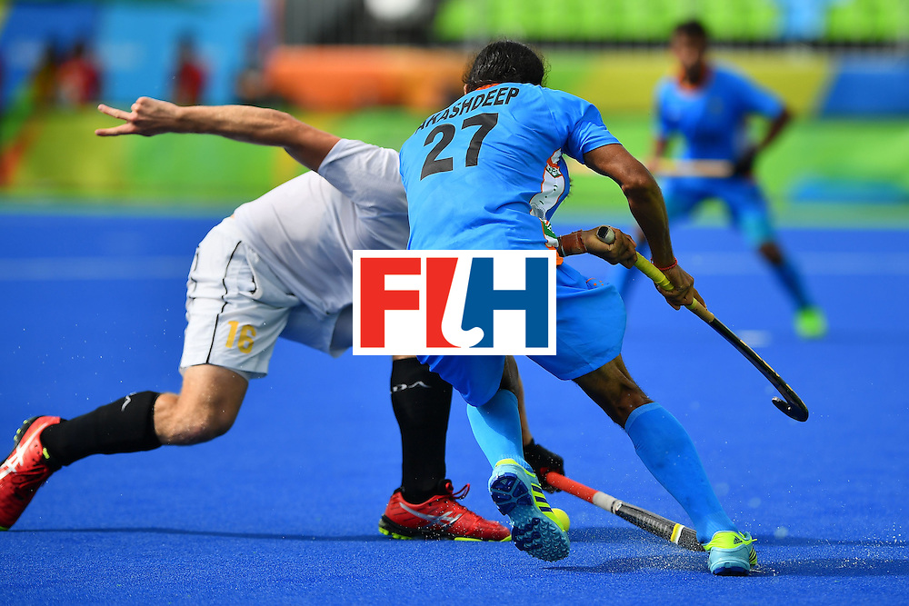 India's Akashdeep Singh (R) and Canada's Gordon Johnston during the mens's field hockey India vs Canada match of the Rio 2016 Olympics Games at the Olympic Hockey Centre in Rio de Janeiro on August, 12 2016. / AFP / Carl DE SOUZA        (Photo credit should read CARL DE SOUZA/AFP/Getty Images)