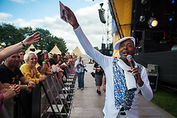 © Licensed to London News Pictures . 09/08/2015 . Siddington , UK . LEEE JOHN performs . The Rewind Festival of 1980s music , fashion and culture at Capesthorne Hall in Macclesfield . Photo credit: Joel Goodman/LNP