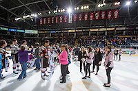 KELOWNA, CANADA - MARCH 21: The Kelowna Rockets hand over the third jersey of the season to winners on March 21, 2015 at Prospera Place in Kelowna, British Columbia, Canada.  (Photo by Marissa Baecker/Shoot the Breeze)  *** Local Caption ***
