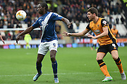 Clayton Donaldson of Birmingham city  and Hull City defender Alex Bruce during the Sky Bet Championship match between Hull City and Birmingham City at the KC Stadium, Kingston upon Hull, England on 24 October 2015. Photo by Ian Lyall.