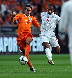 Robin Van Persie of Holland and Glen Johnson of  England during the International Friendly between Netherlands and England at the Amsterdam Arena on August 12, 2009 in Amsterdam, Netherlands.