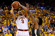June 3, 2018; Oakland, CA, USA; Cleveland Cavaliers guard George Hill (3) shoots the ball against Golden State Warriors guard Nick Young (6) during the second quarter in game two of the 2018 NBA Finals at Oracle Arena.