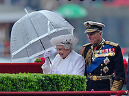 "THE QUEEN AND DUKE OF EDINBURGH .disembark from the ""Spirit of Chartwell"" after participating in the Thames Pageant..They were joined by Prince Charles, Camilla, Duchess of Cornwall and Prince Harry for the procession up the Thames to mark the Diamond Jubilee of Queen Elizabeth ll..The Royals braved a toprrential downpour as they watched the flotilla of 1,000 boats file past them alongside the HMS President, Katherine Docks, London_03/06/2012.Mandatory credit photo: ©DIASIMAGES..(Failure to credit will incur a surcharge of 100% of reproduction fees)..                **ALL FEES PAYABLE TO: ""NEWSPIX INTERNATIONAL""**..IMMEDIATE CONFIRMATION OF USAGE REQUIRED:.DiasImages, 31a Chinnery Hill, Bishop's Stortford, ENGLAND CM23 3PS.Tel:+441279 324672  ; Fax: +441279656877.Mobile:  07775681153.e-mail: info@newspixinternational.co.uk"