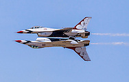 "The U.S. Air Force Thunderbirds ""F-16 Fighting Falcon"" performs in in the Los Angeles County Air Show at William J Fox Airport  in Lancaster, California on March 21, 2015."